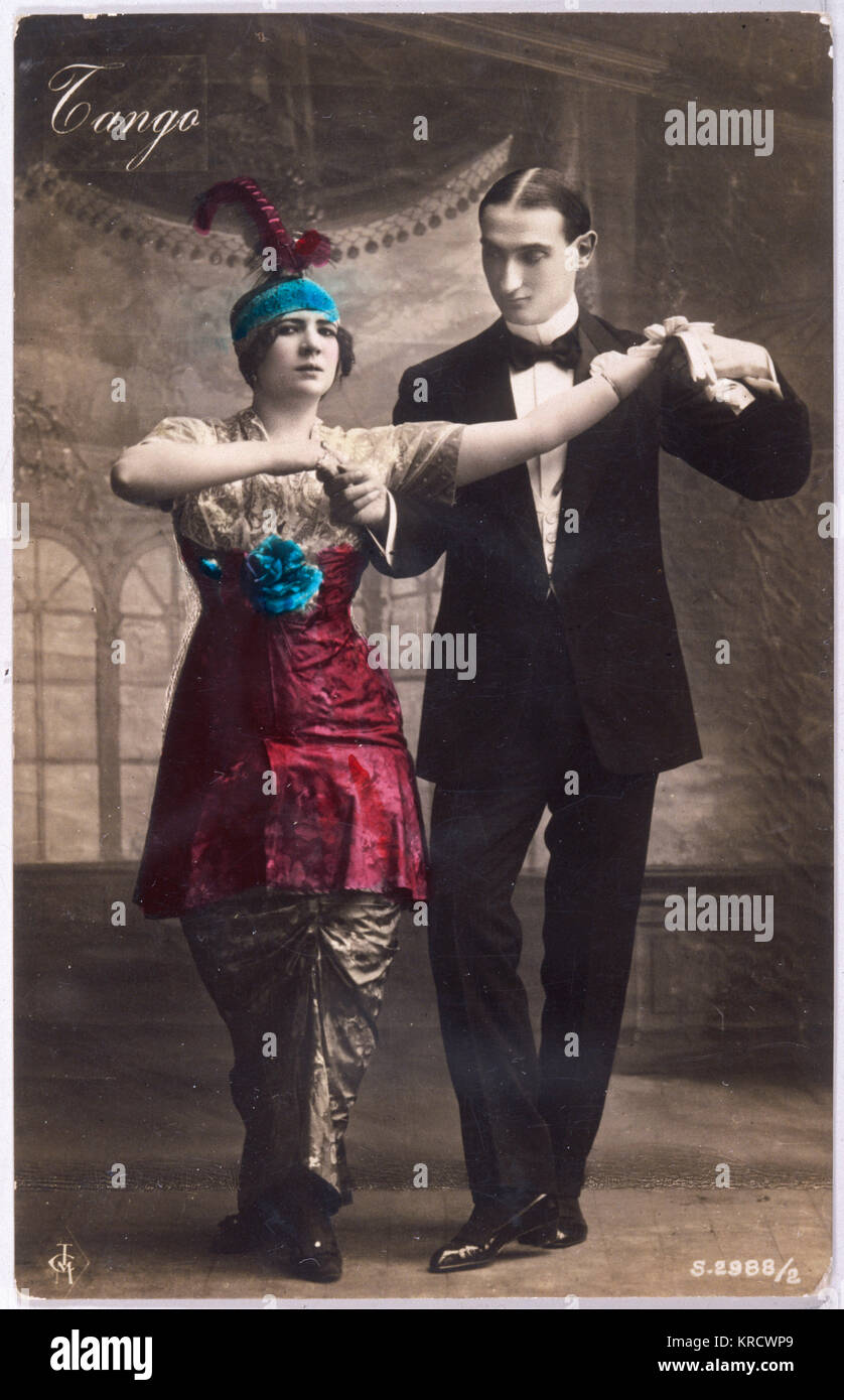 She looks a bit apprehensive as she prepares to dance the tango with her smooth partner Date: 1914 - Stock Image