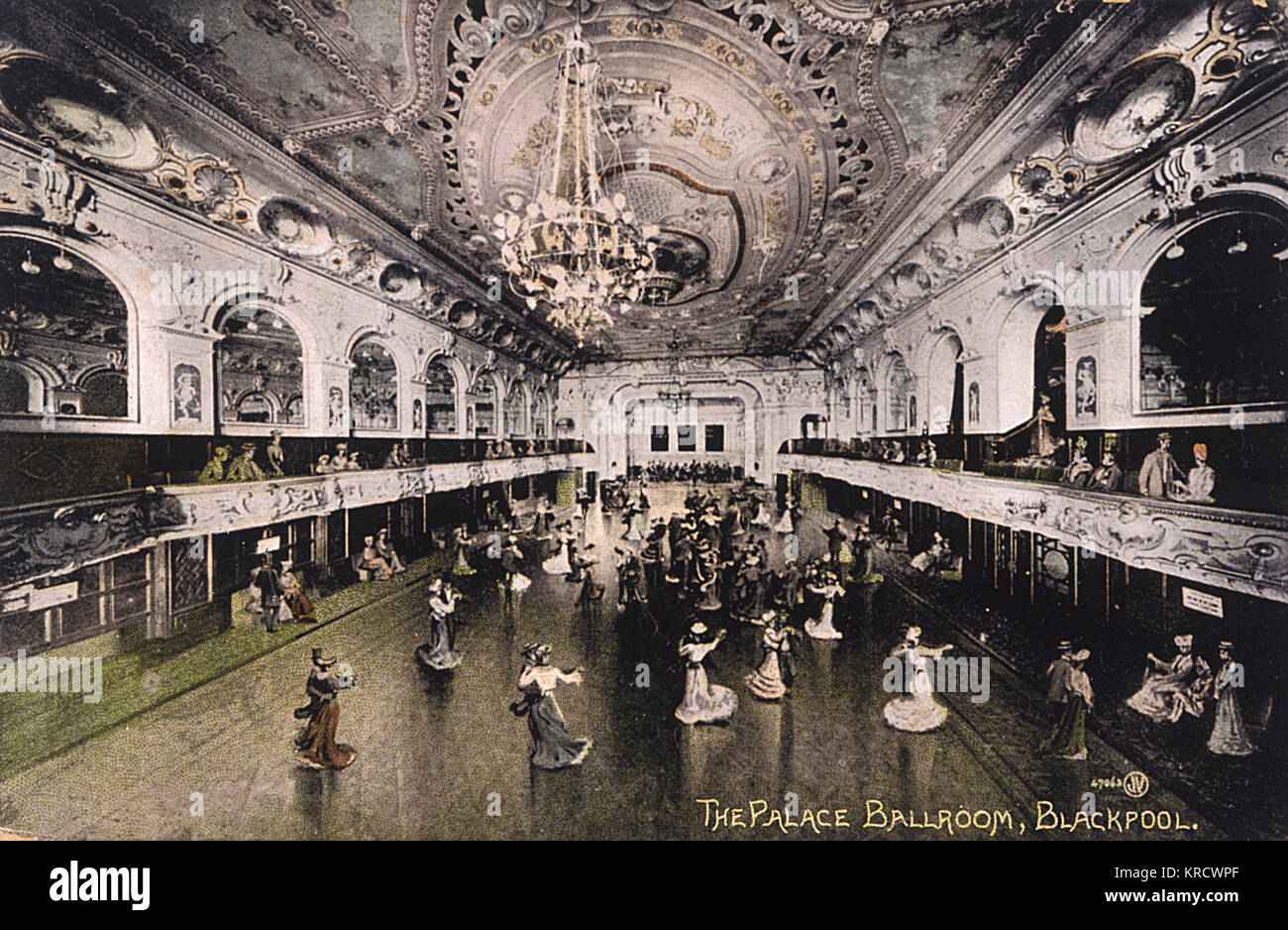 Ladies in long skirts swirl across the spacious dance floor of the Palace Ballroom, Blackpool : skilful retouching - Stock Image