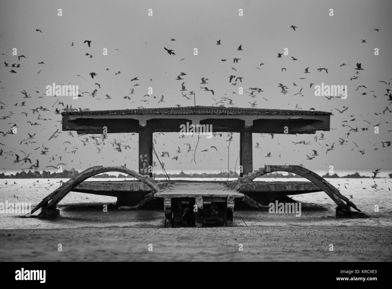 The bridge abandoned  at the seaside in Black Sea at Mamaia resort, Constanta, Romania.The bridge over Black Sea, - Stock Image