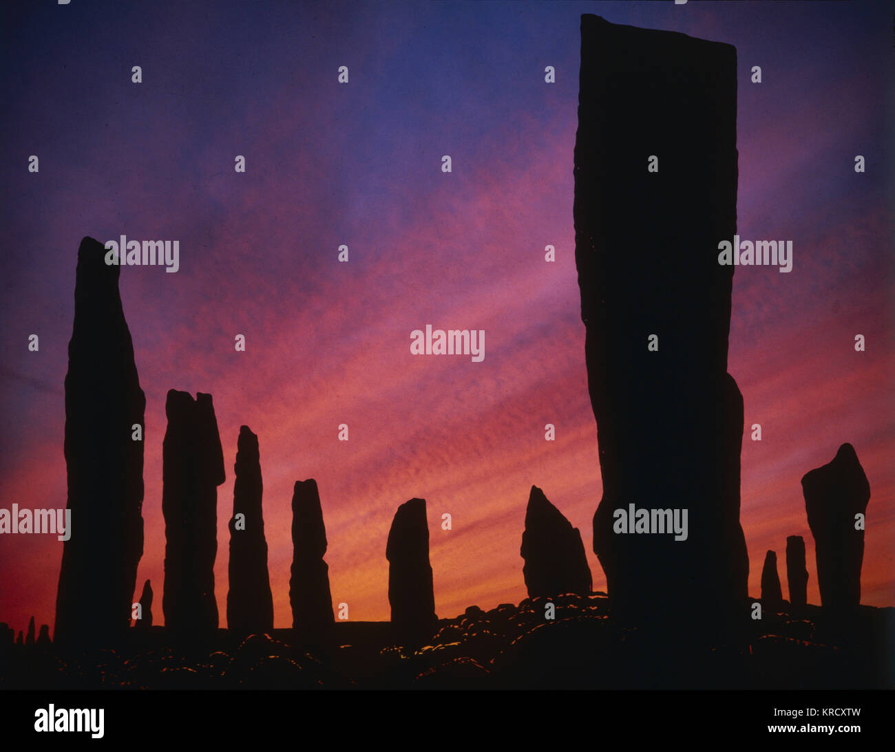 Sunset over the ancient standing stones of Callanish  Stone Circle, Isle of Lewis, outer Hebrides, Scotland.    - Stock Image
