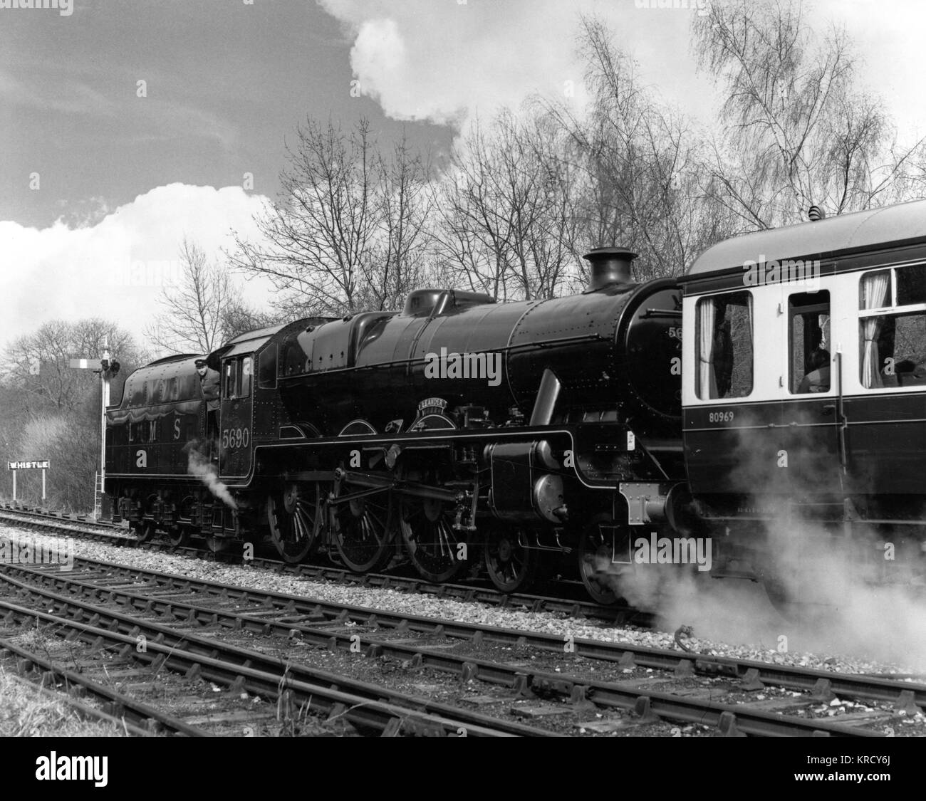 A reversed steam locomotive  shunting its carriages at  Highley Station, Severn Valley  Railway, which still runs - Stock Image