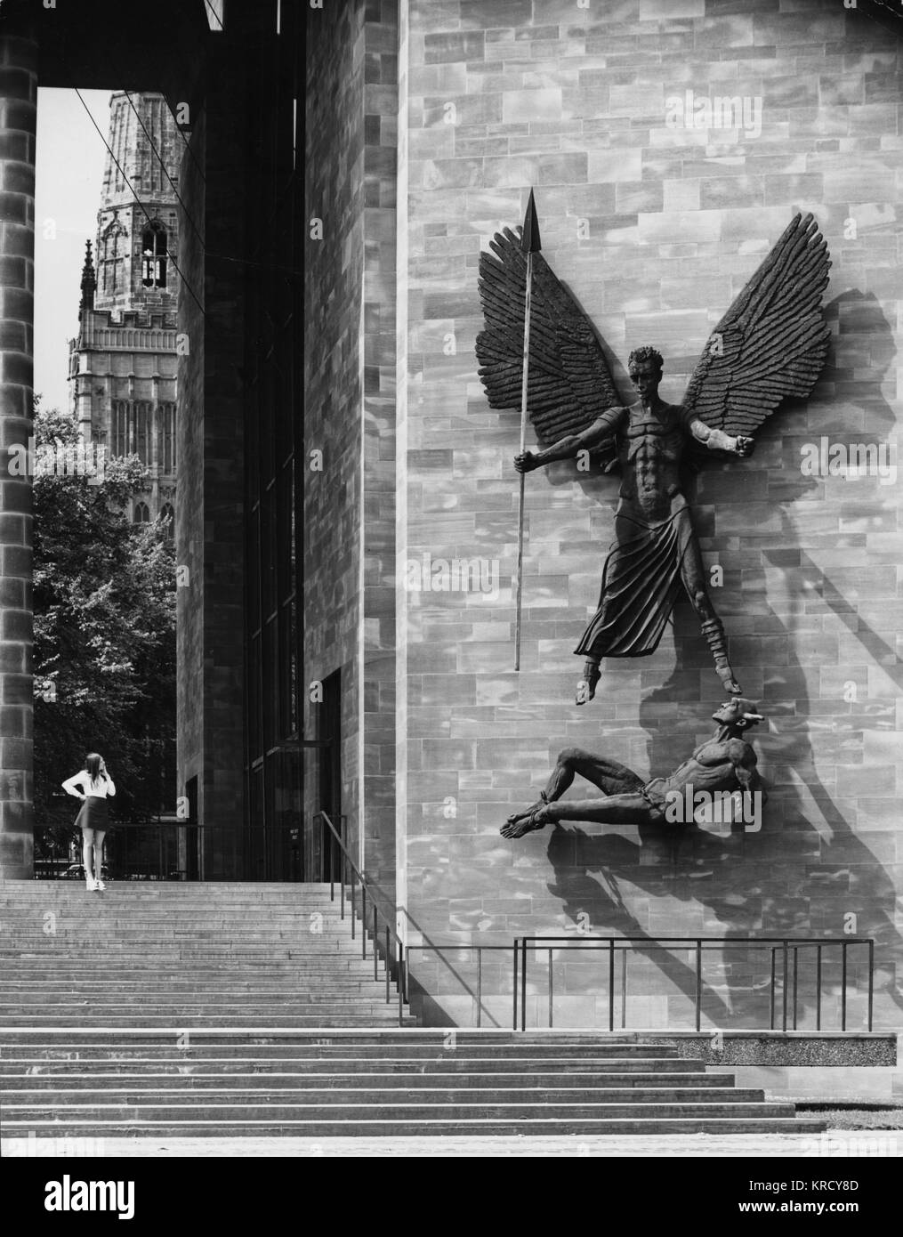 The enormous (6 metres high) sculpture of St. Michael defeating the Devil (Lucifer) sculpted (1958) by Sir Jacob - Stock Image