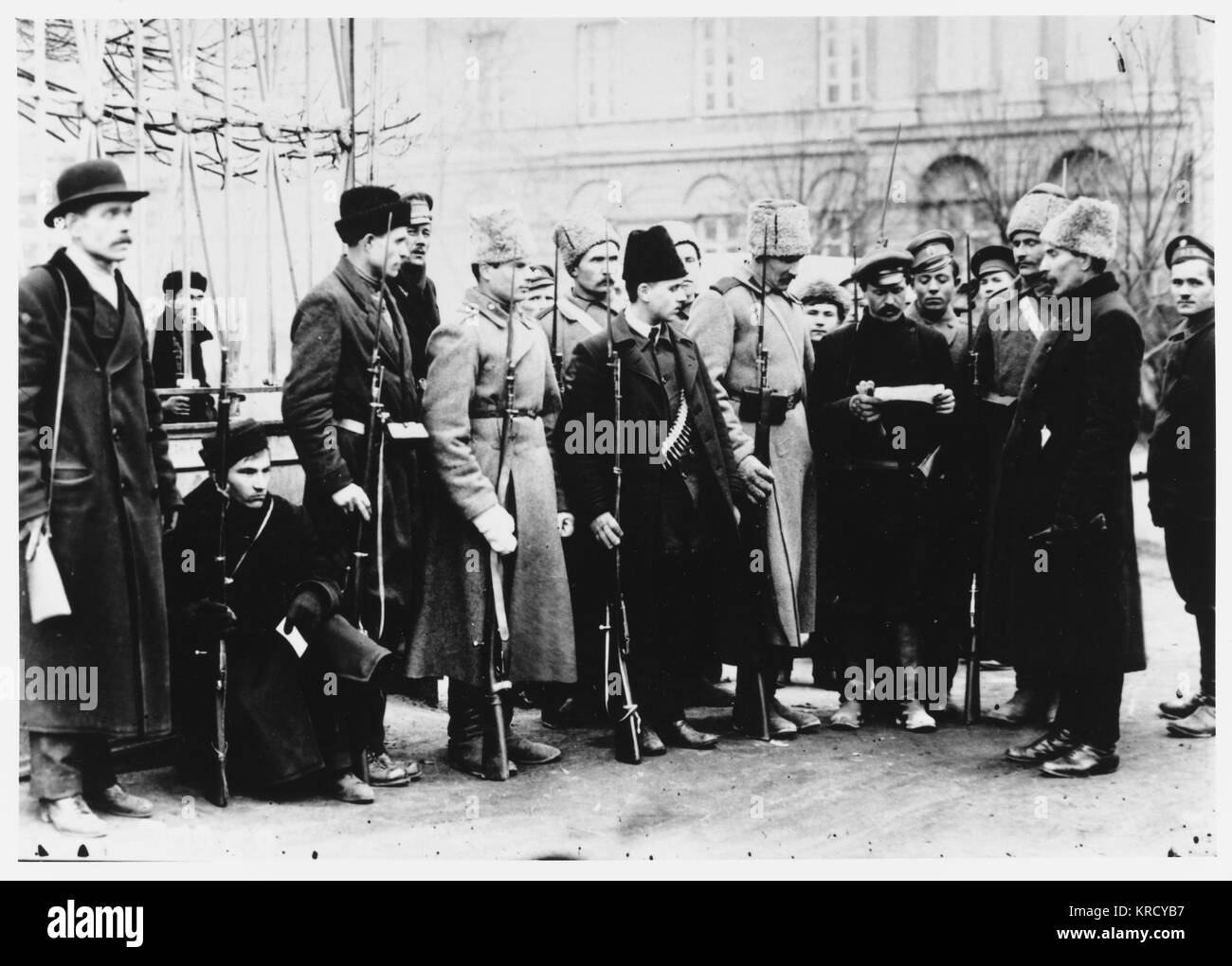 Members of the Red Guard check  people's identification papers  in the streets of Petrograd :  revolutions come - Stock Image
