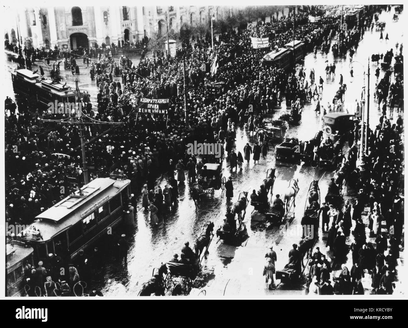 Women are prominent in a  parade by dissidents on the  Nevski Prospekt, Petrograd.        Date: March 1917 - Stock Image