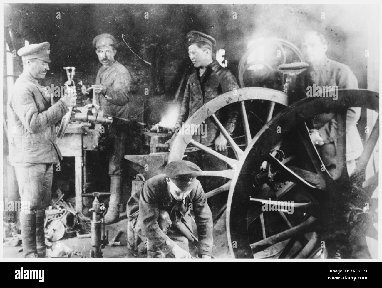 Engineers of the Red Army's  24th Division repair a gun in  a workshop installed on a  train, enabling it to be Stock Photo