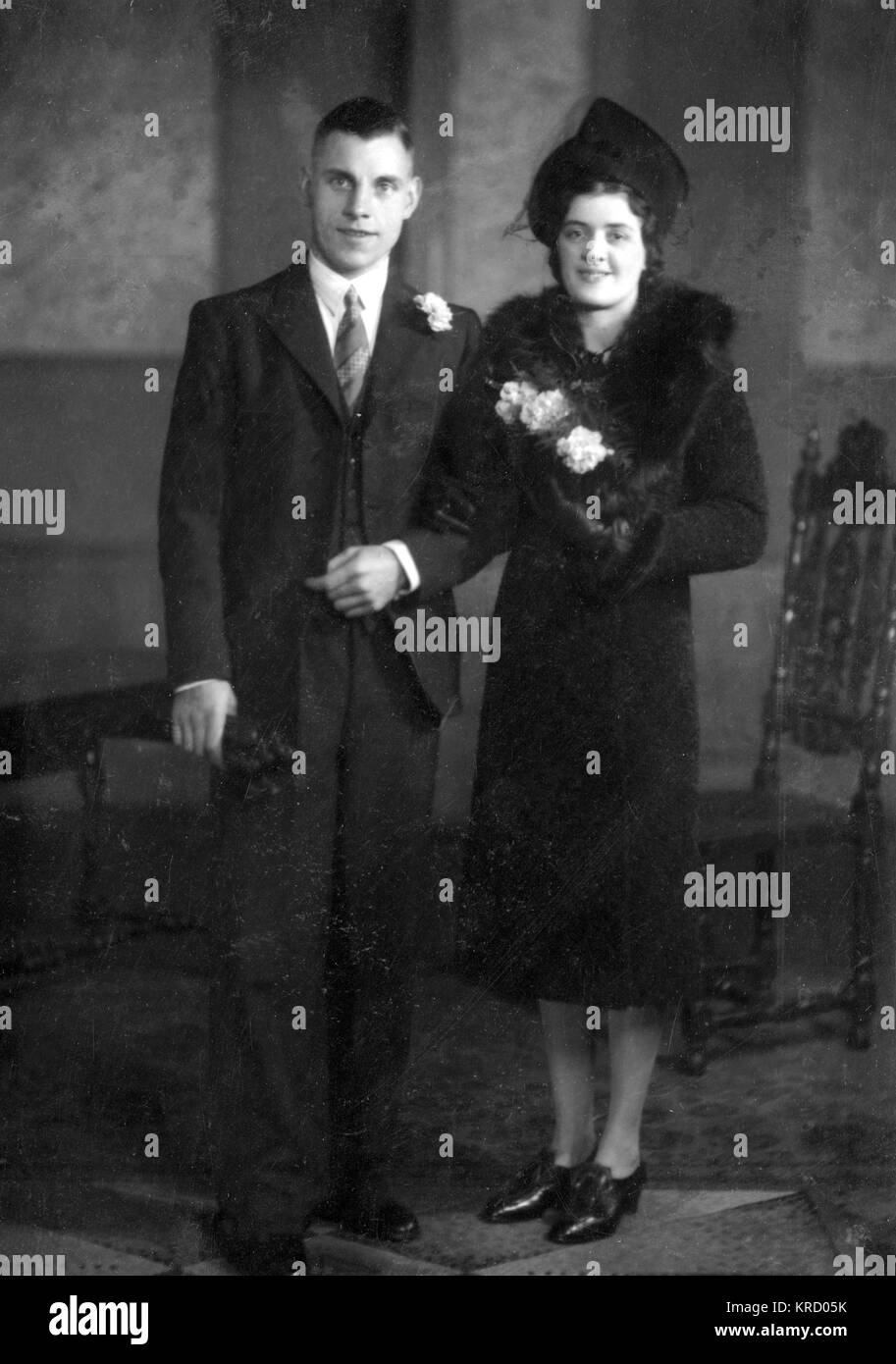 The happy couple in a wedding photo, dressed unusually in black!         Date: circa 1930s - Stock Image