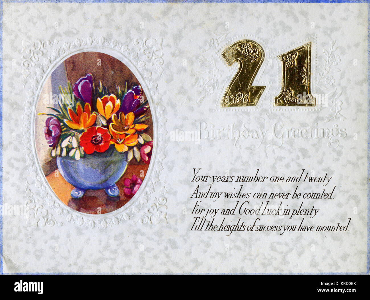 A 21st birthday card with a vase of colourful flowers in an oval frame.       Date: 1936 Stock Photo