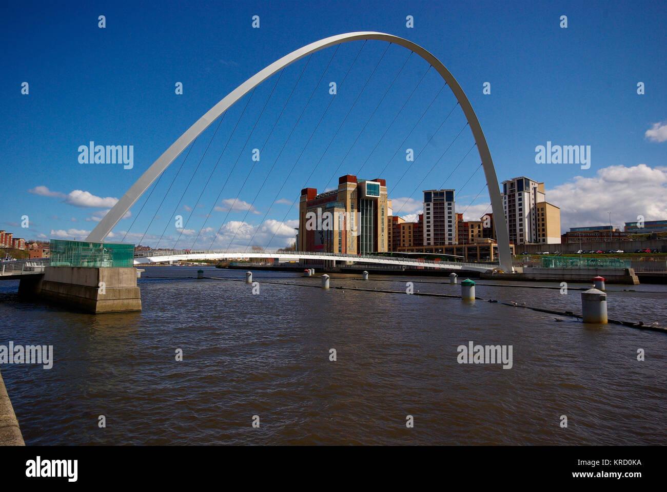 The Gateshead Millennium Bridge. A pedestrian and cyclist tilt bridge spanning the River Tyne Gateshead on the south - Stock Image