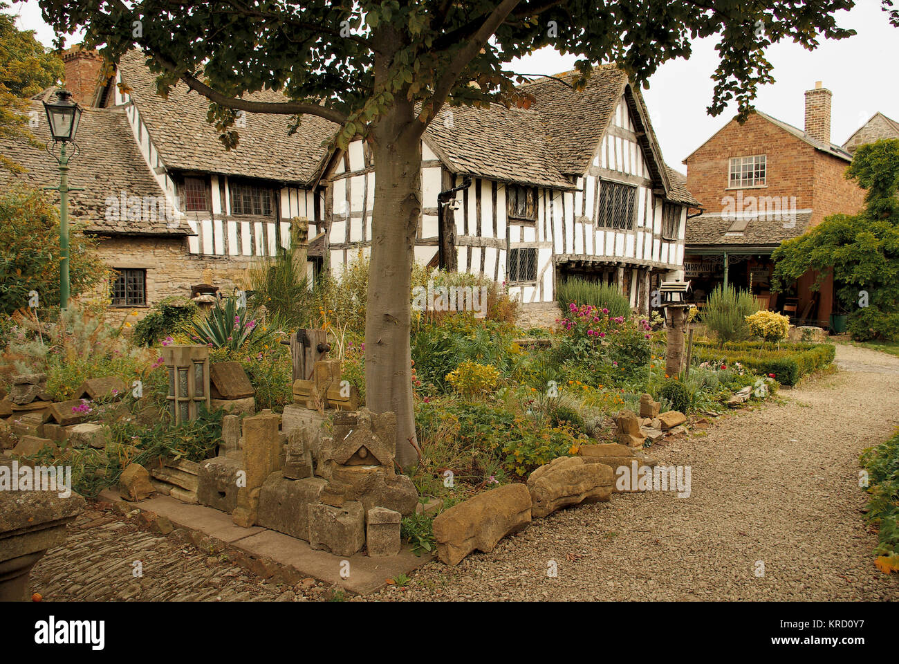 The Almonry, Evesham, Worcestershire, viewed across a rockery style garden.  The 14th century building was once - Stock Image