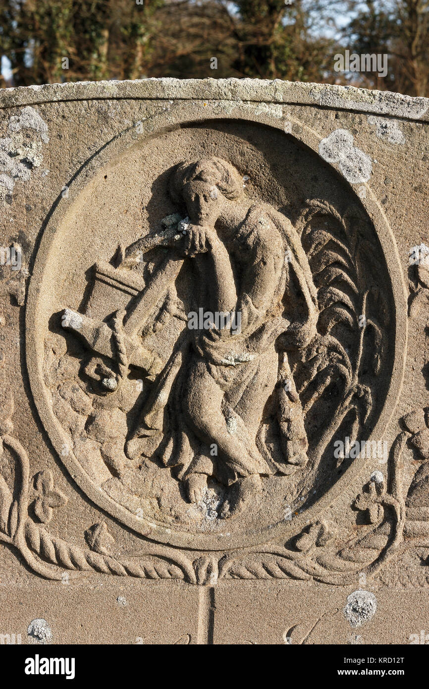 Detail of a headstone carving at St Mary's Church, now a mortuary chapel, at Knightwick in the Teme Valley, - Stock Image