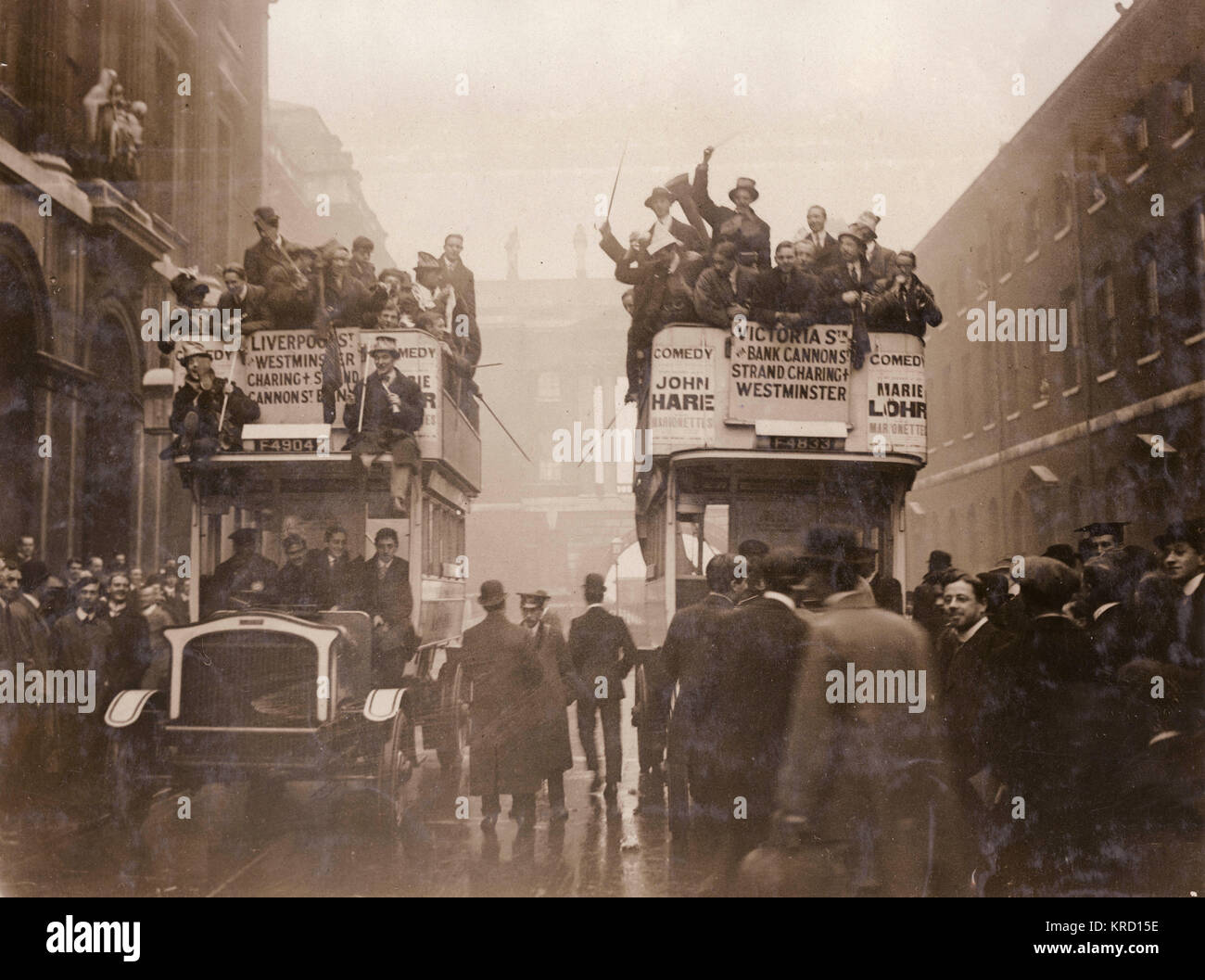 King's College students in high spirits, on two buses which are about to leave the Strand campus for Wormwood - Stock Image