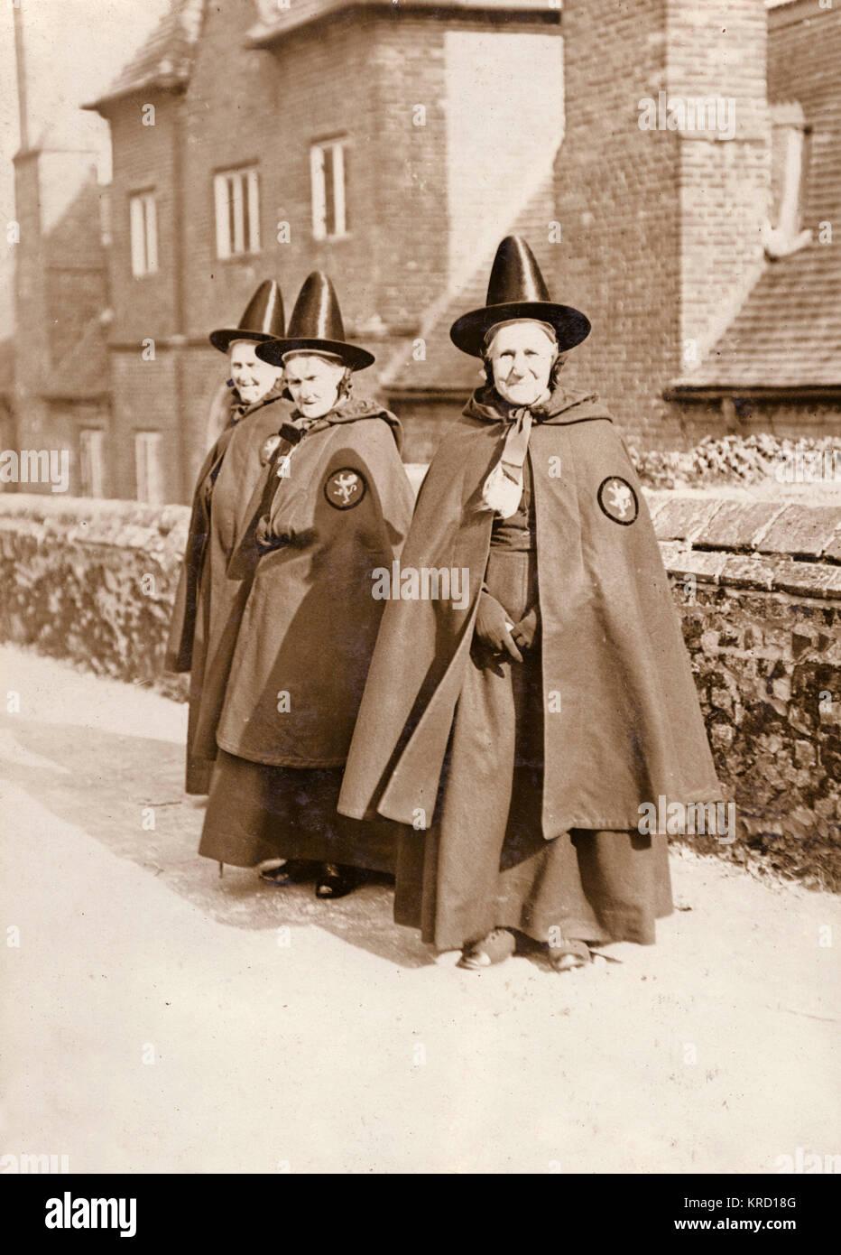 Three bedeswomen of Castle Rising, near Sandringham in Norfolk.  When these elderly women enter the almshouses (known - Stock Image