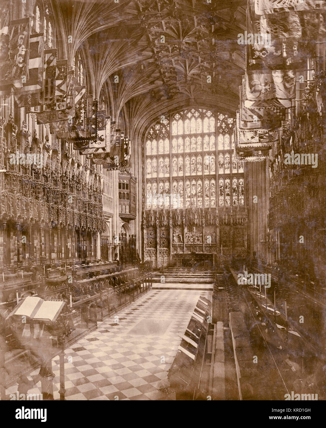Interior of St George's Chapel, Windsor, at the time of the funeral of King Edward VII, showing the ornate gothic choir stalls, fan vaulting on the ceiling and stained glass windows.      Date: May 1910 Stock Photo