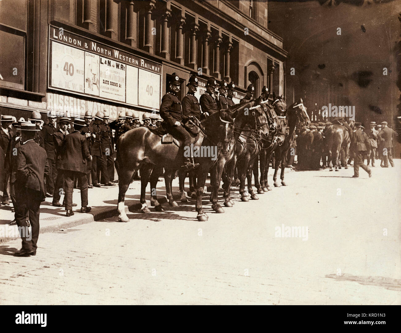 Policemen on horseback guarding Liverpool Station during the general transport strike of 1911.  The strike began - Stock Image