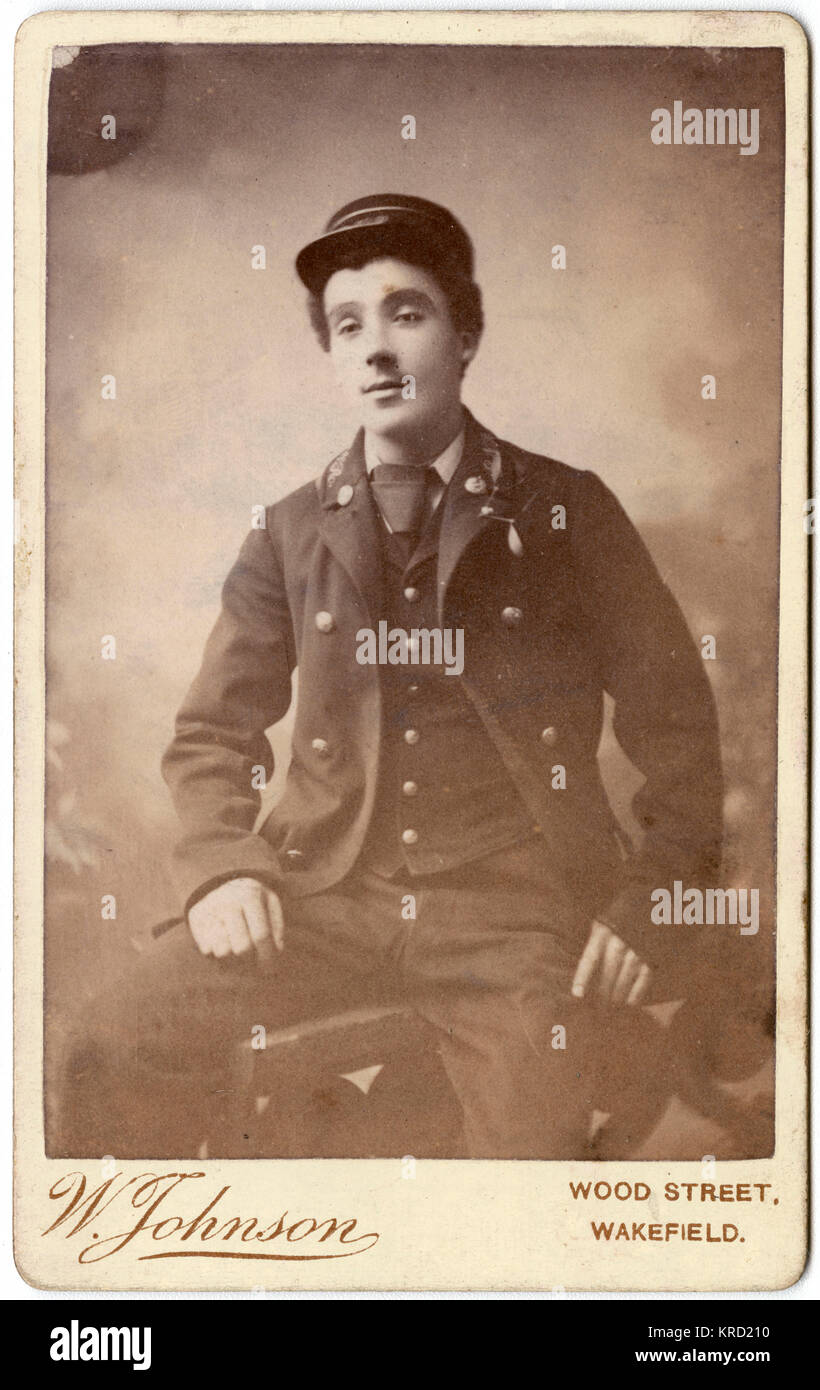 A young Victorian railwayman poses in his uniform.       Date: circa 1880s - Stock Image