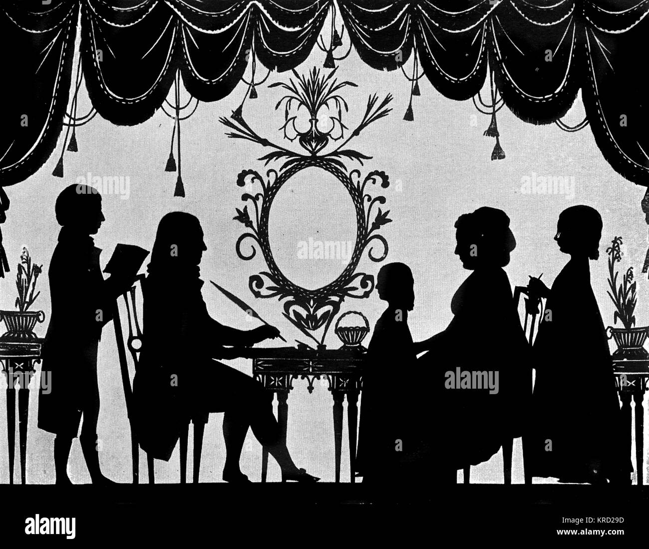 A silhouette portrait of the Burney family (possibly that of the musical historian, Charles Burney?), pictured in - Stock Image