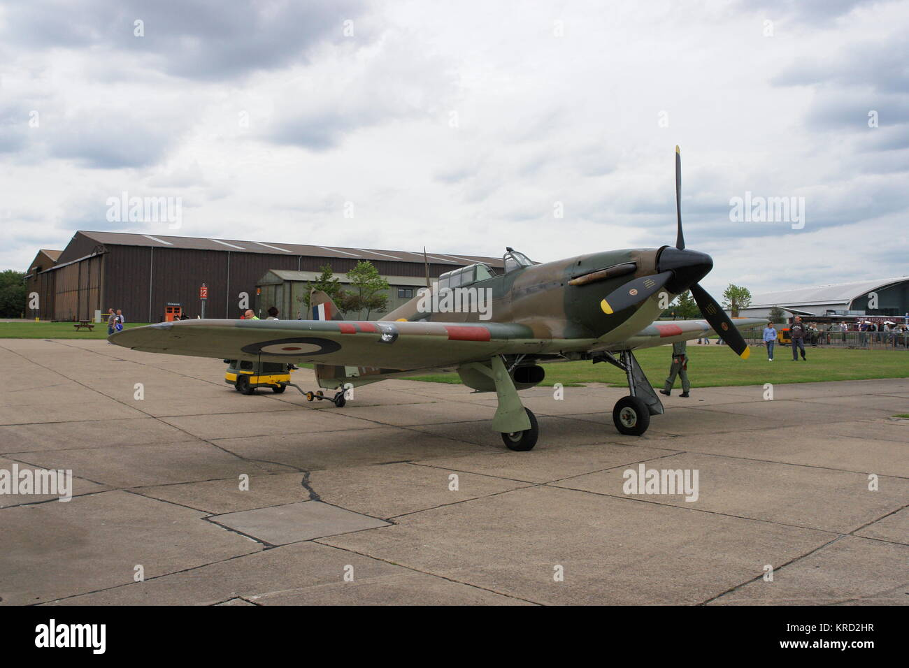 A Hurricane fighter plane, active during the Second World War, on an airfield, possibly at an air museum.      Date: - Stock Image