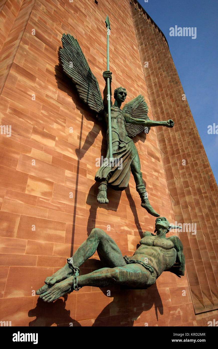 Bronze sculpture entitled St Michael's Victory over the Devil, on an outer wall of Coventry Cathedral.  It was - Stock Image
