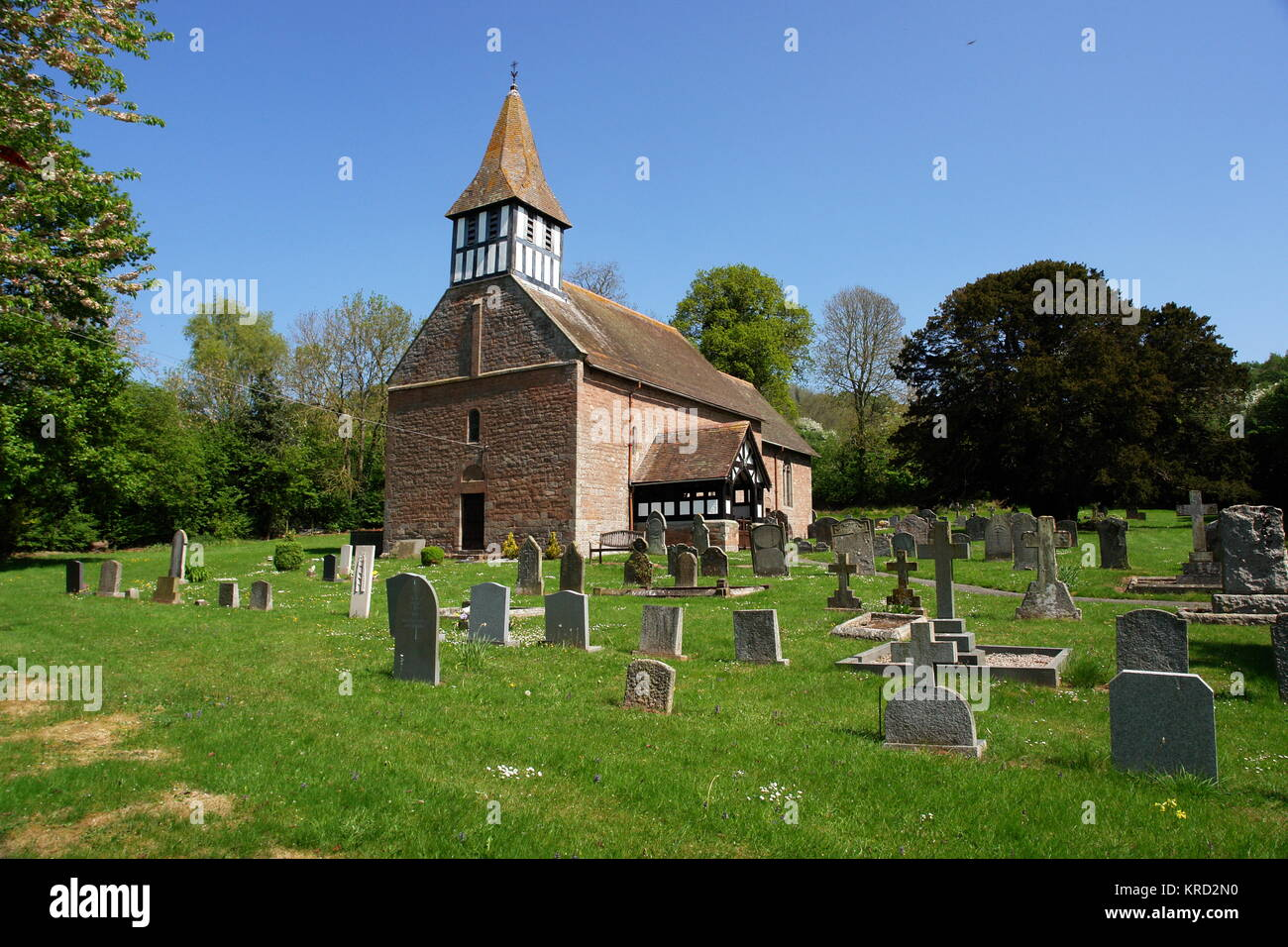 St Michael and All Angels Church, a Norman church in Castle Frome, Herefordshire, seen from across the churchyard. Stock Photo