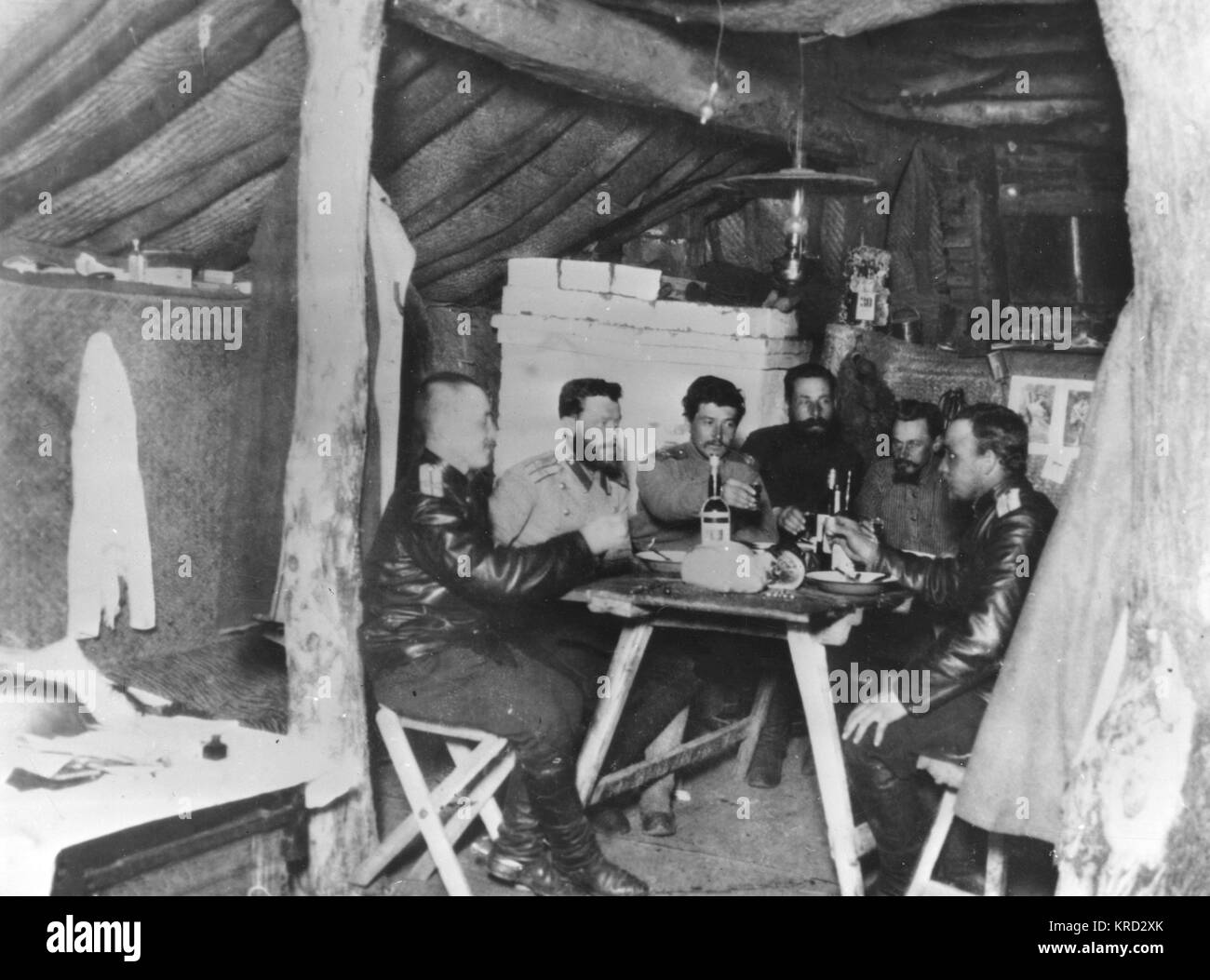 A group of six Russian officers relax in their dugout during the second and final year of the Russo-Japanese War. - Stock Image