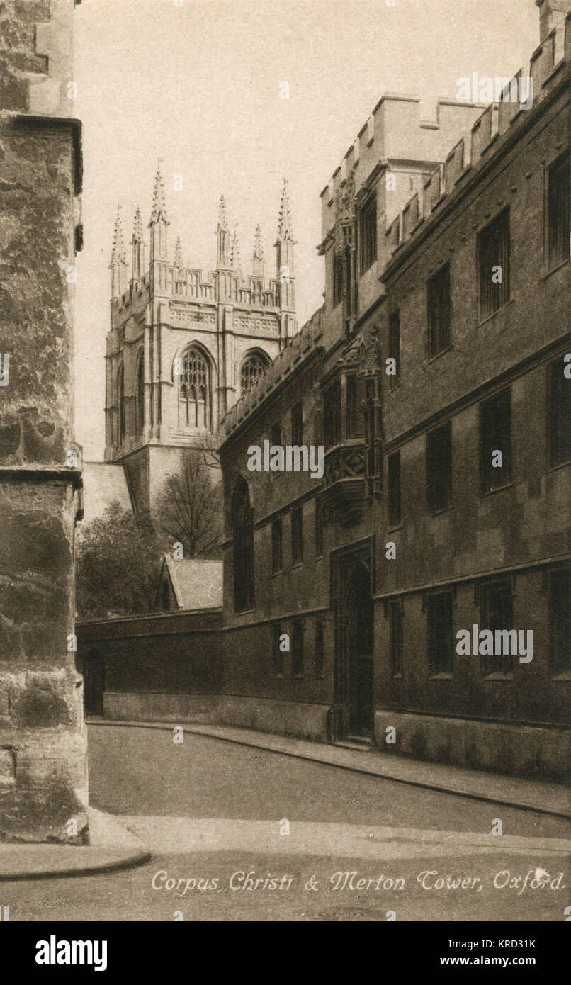 Oxford: Merton College Tower viewed from the street, with Corpus Christi College in the foreground.     Date: 1920s - Stock Image