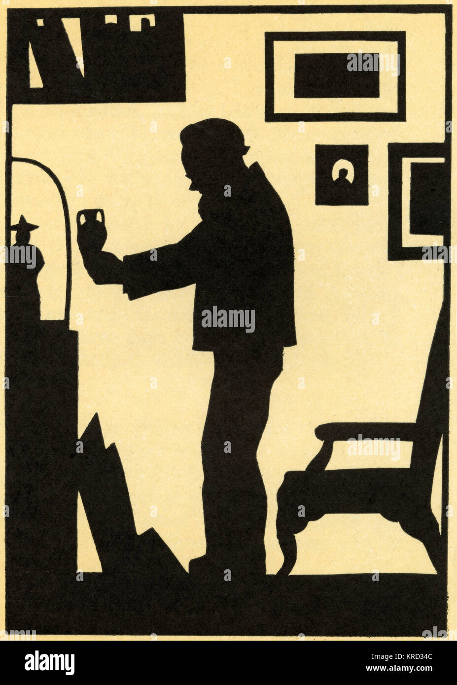 An antique shop owner, admiring a small vase, pictured in silhouette.     Date: 1926 - Stock Image