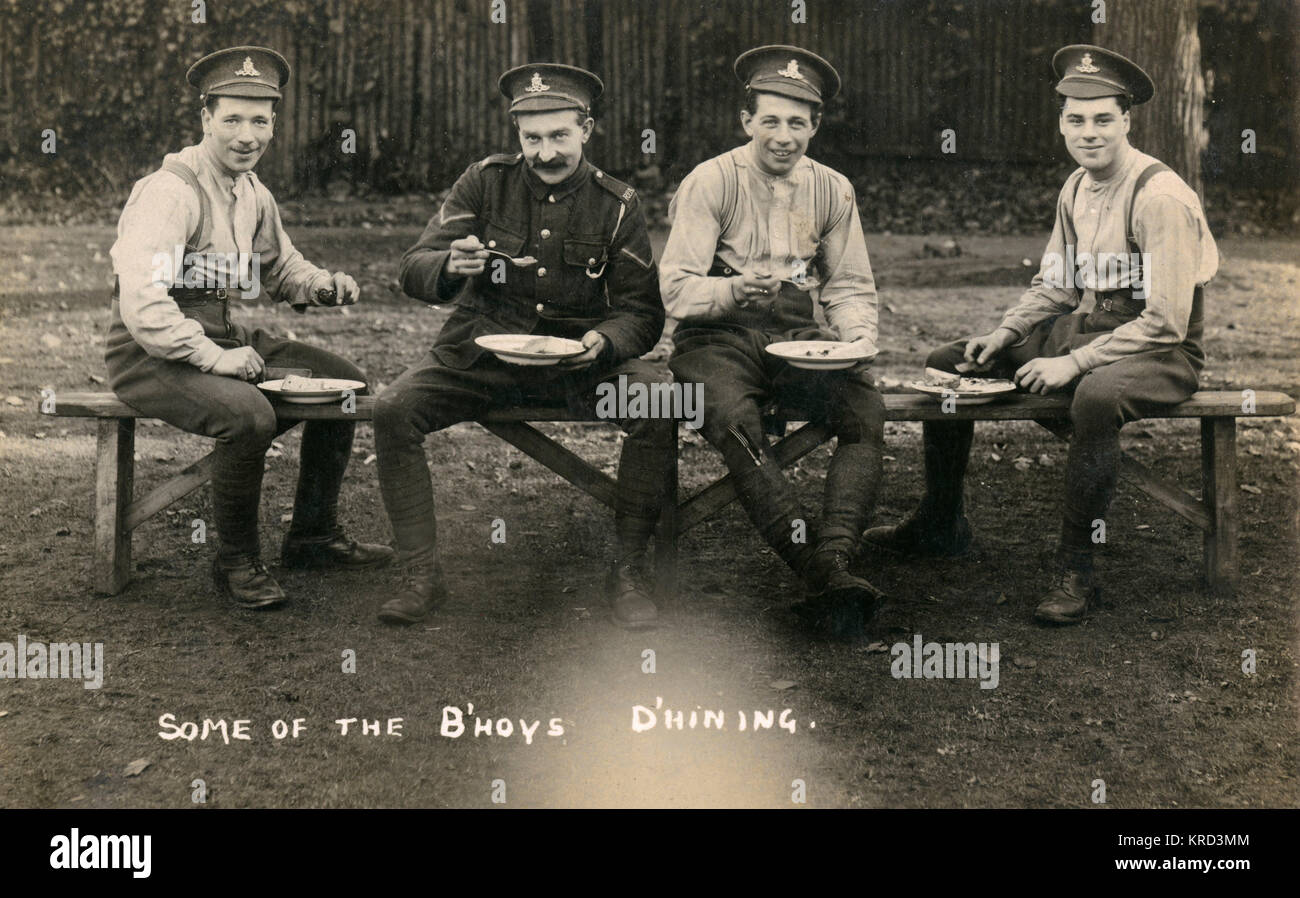 Four soldiers of the Royal Artillery enjoy some lunch during the First World War.     Date: c.1916 Stock Photo