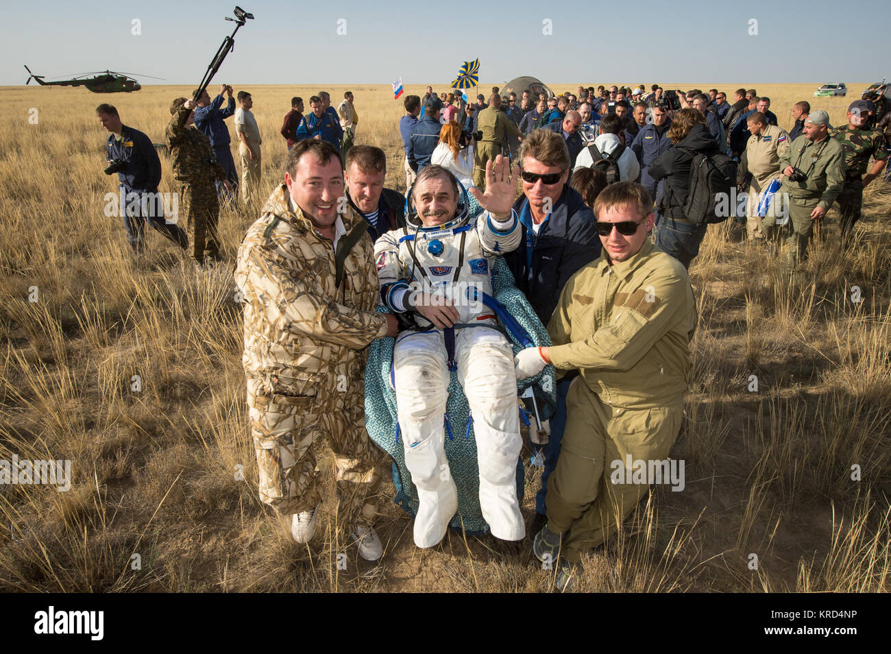 Expedition 36 Commander Pavel Vinogradov of the Russian Federal Space Agency (Roscosmos) is carried to the medical - Stock Image