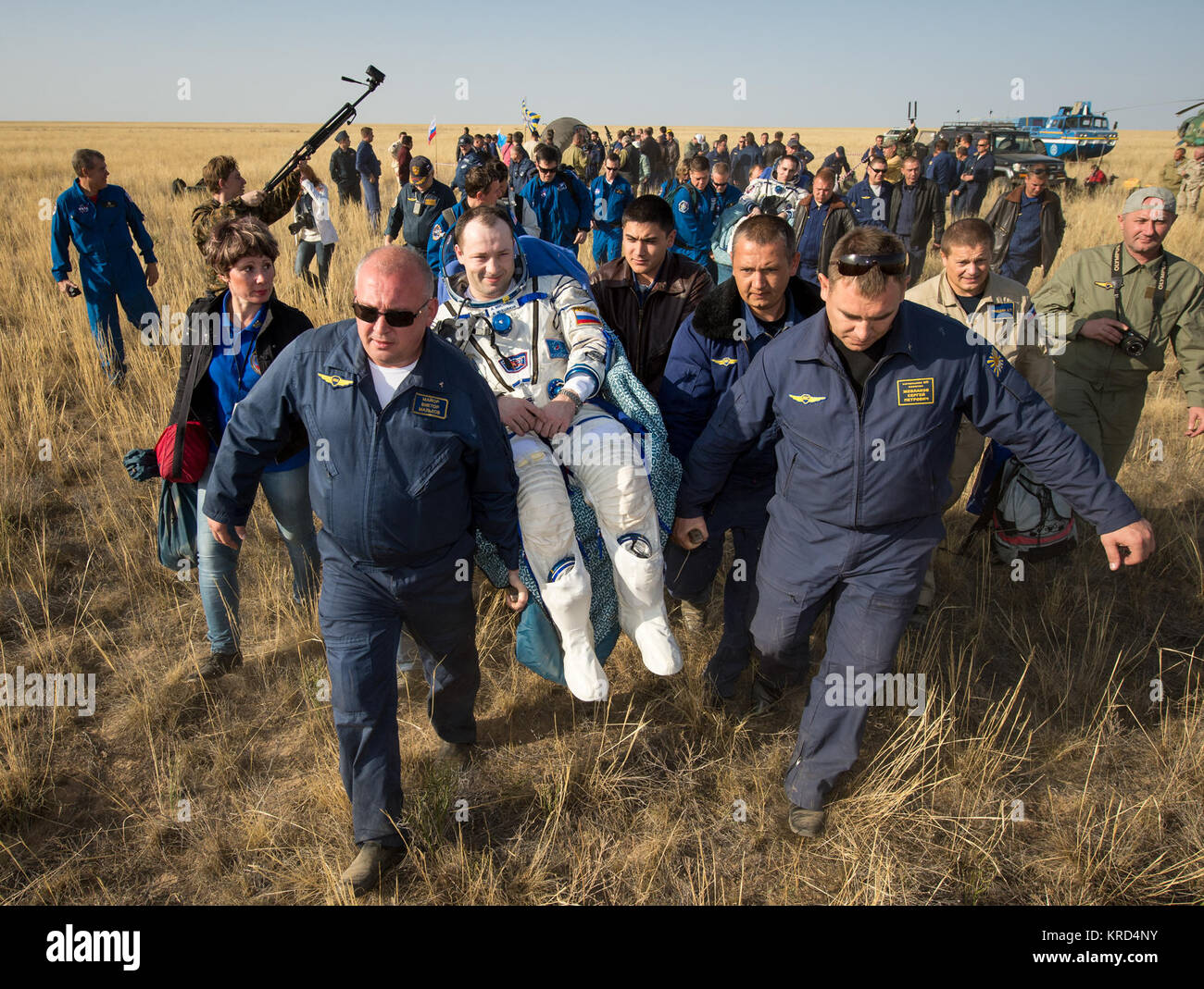 Expedition 36 Flight Engineer Alexander Misurkin of the Russian Federal Space Agency (Roscosmos) is carried to the - Stock Image