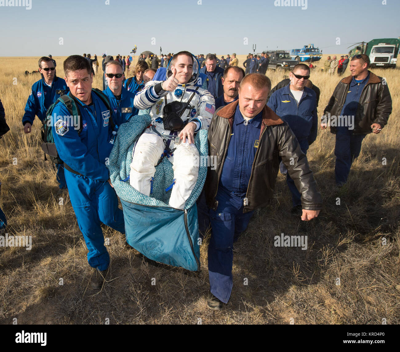 Expedition 36 Flight Engineer Chris Cassidy of NASA is carried to the medical tent shortly after he and, Commander - Stock Image