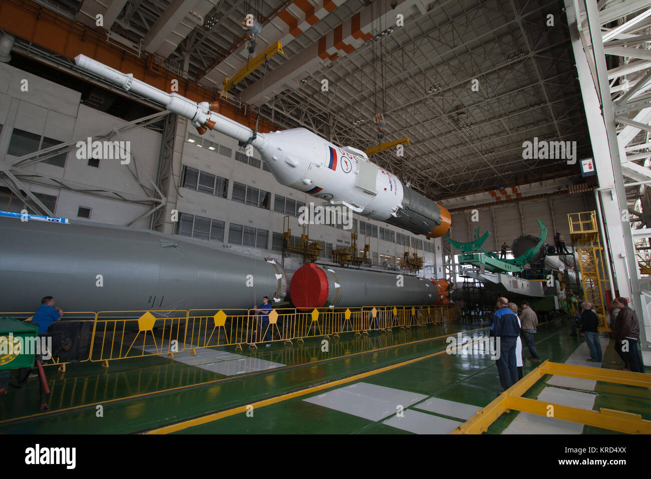 The Soyuz rocket and Soyuz TMA-10M spacecraft are assembled at Building 112 on the Baikonur Cosmodrome, on Sunday, - Stock Image