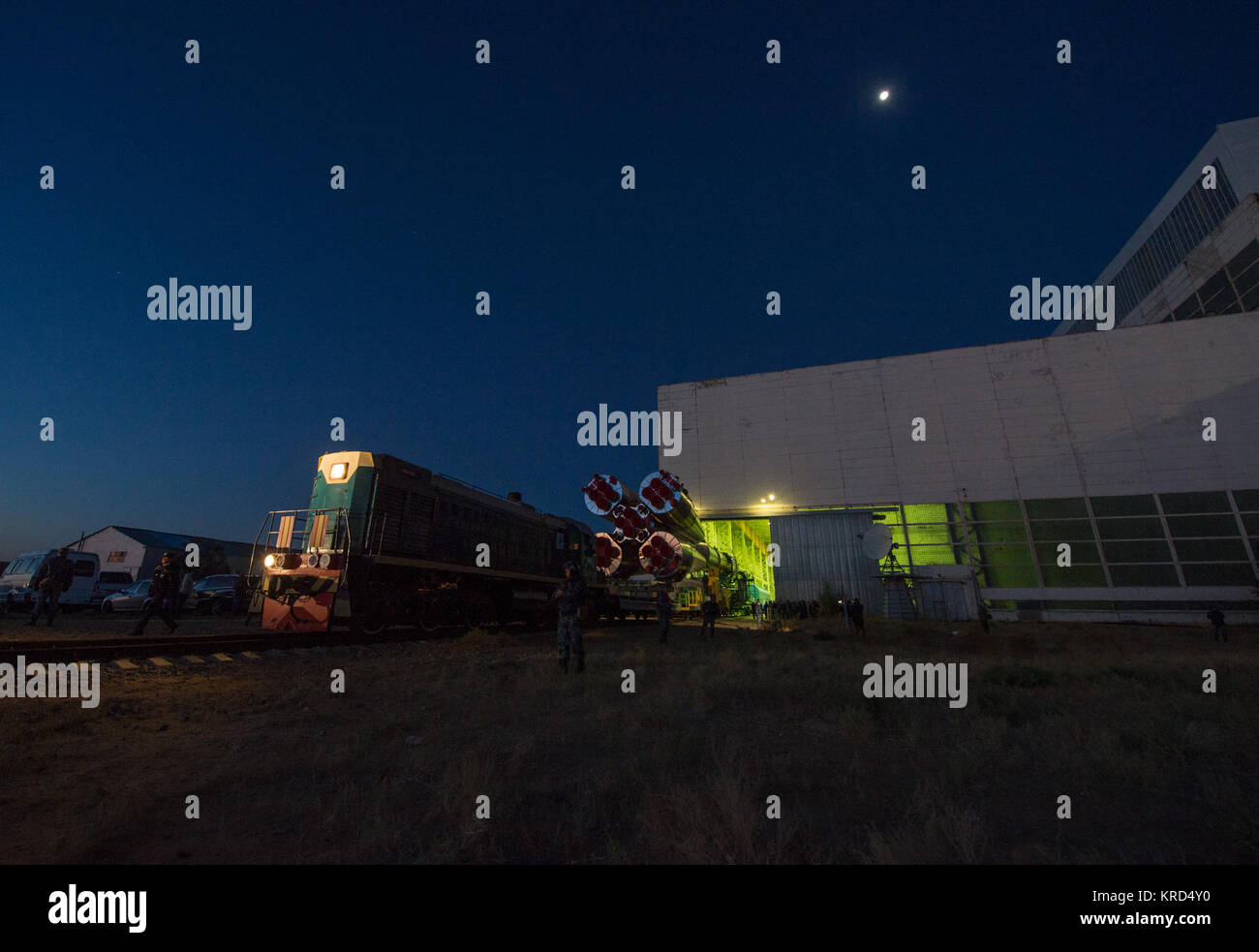 The Soyuz rocket is rolled out of Building 112 at the Baikonur Cosmodrome to make its way to the launch pad, Monday, - Stock Image