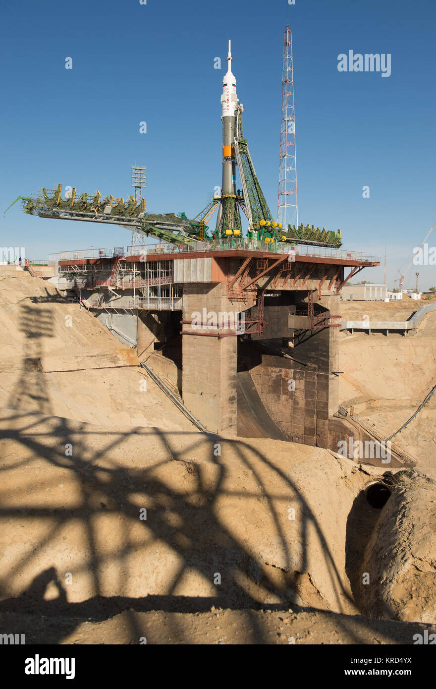 The Soyuz rocket is seen on its launch pad shortly after being lifted into its upright position on Monday, Sept. - Stock Image