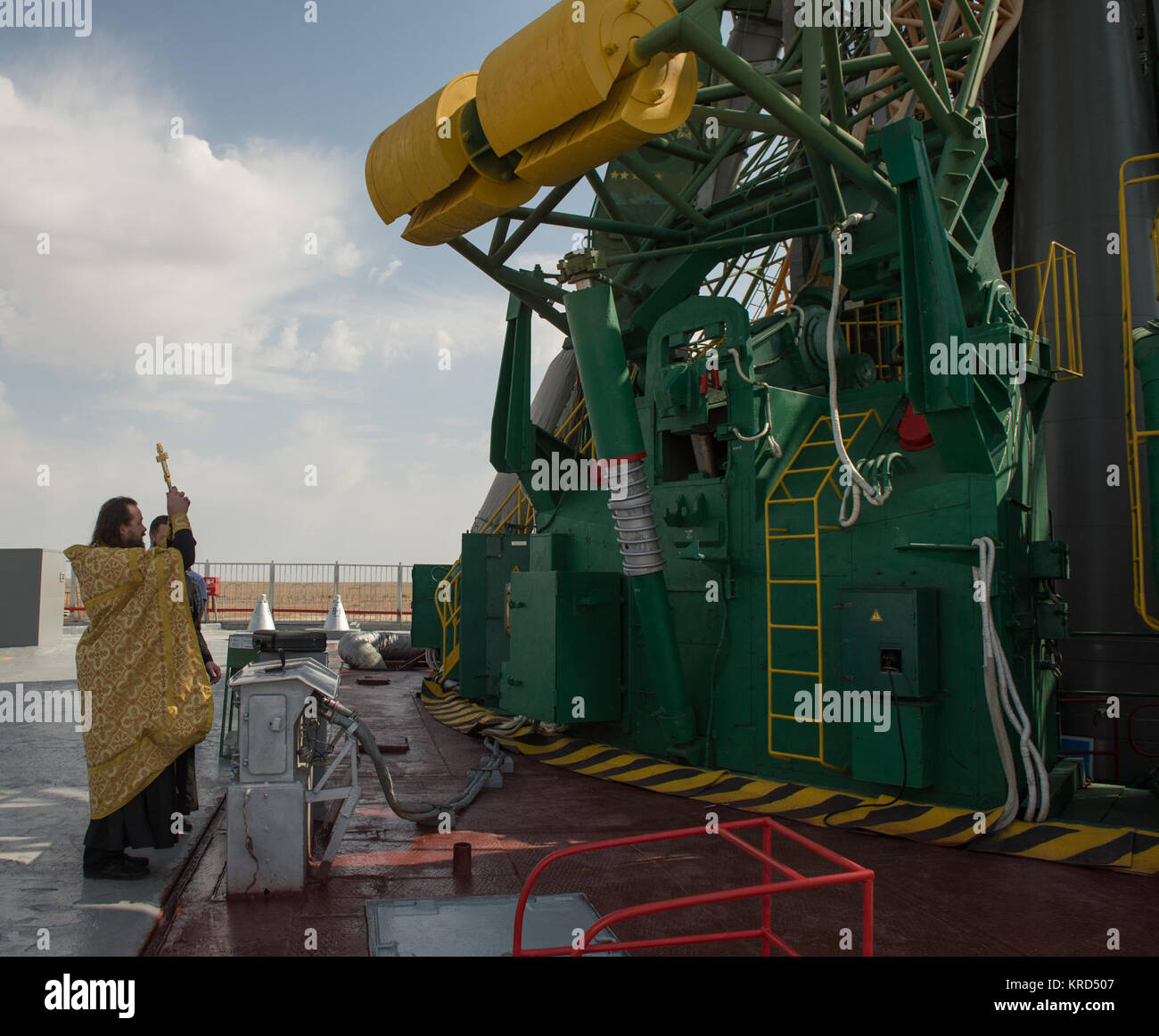 An Orthodox priest blesses the Soyuz rocket at the Baikonur Cosmodrome Launch pad on Tuesday, Sept. 24, 2013 in - Stock Image