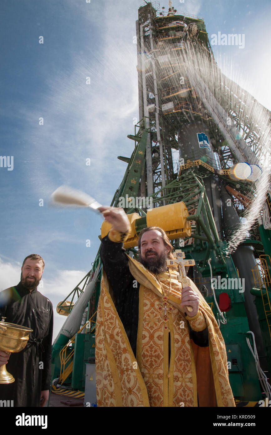 An Orthodox priest blesses members of the public at the the Baikonur Cosmodrome Soyuz launch pad on Tuesday, Sept. - Stock Image