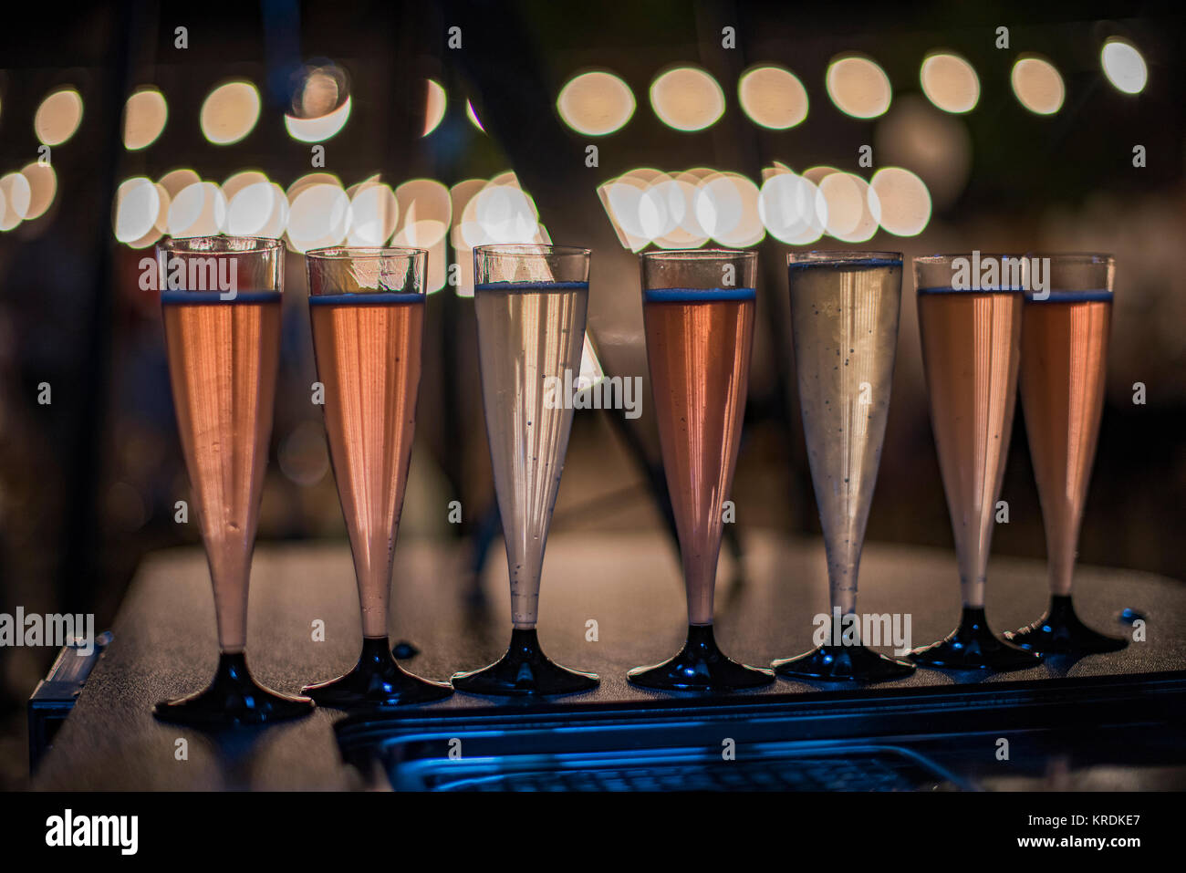Glasses with champagne at night - Stock Image