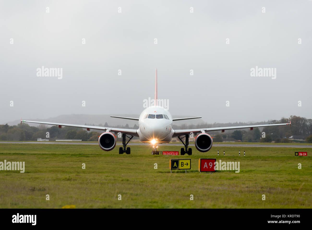 EasyJet passenger airplane G-EZIL Airbus A319-111 taxiing after landing at Edinburgh International Airport. - Stock Image