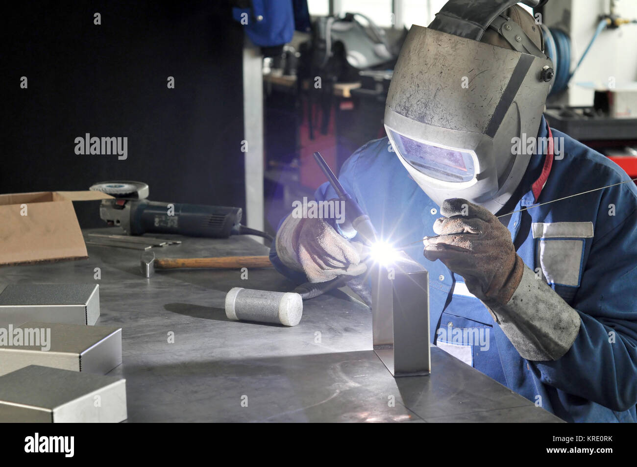 welder works in a metal construction company - Stock Image