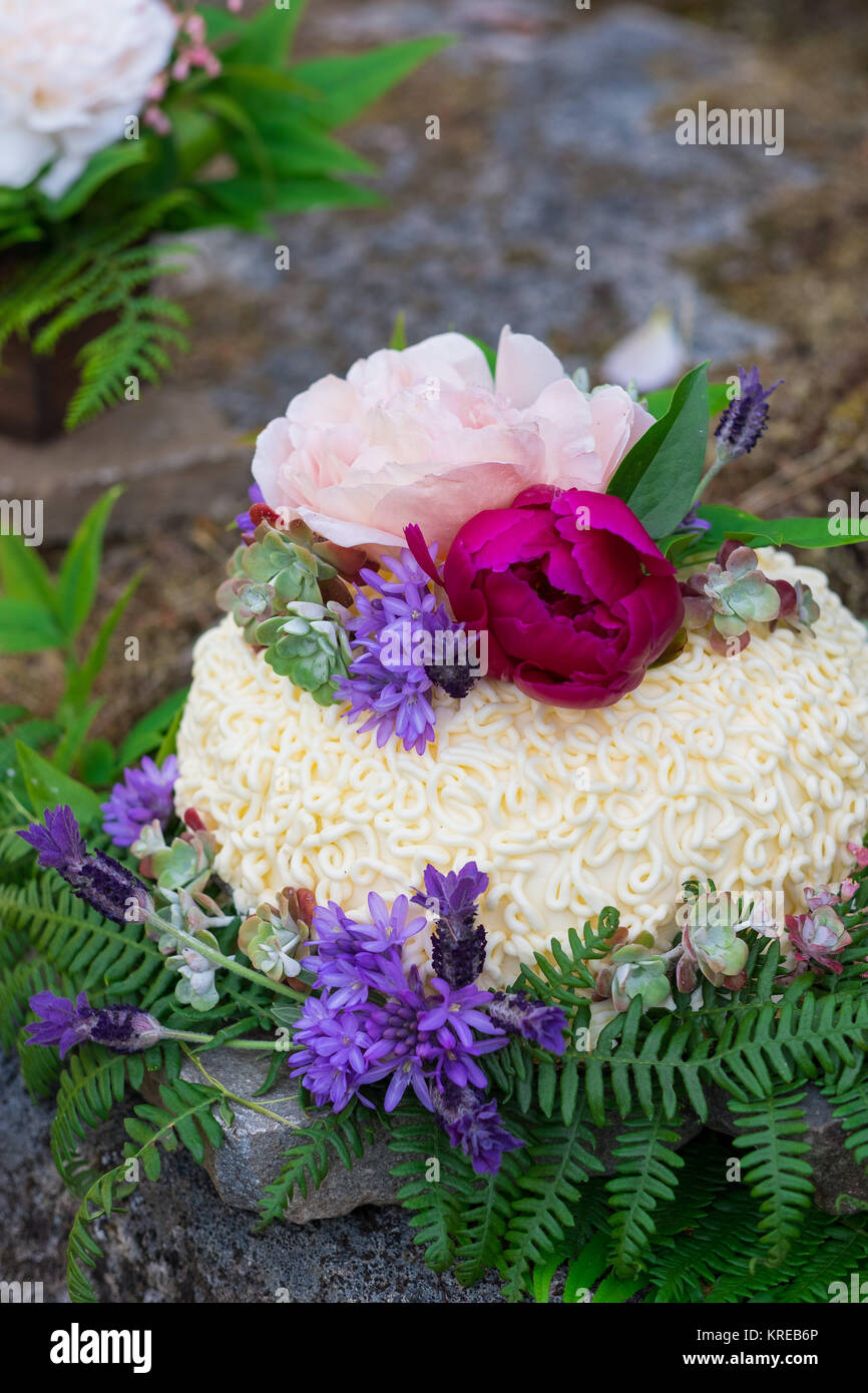 Wedding Cake On River Rock With Native Species Plants And Flowers At A North Umpqua