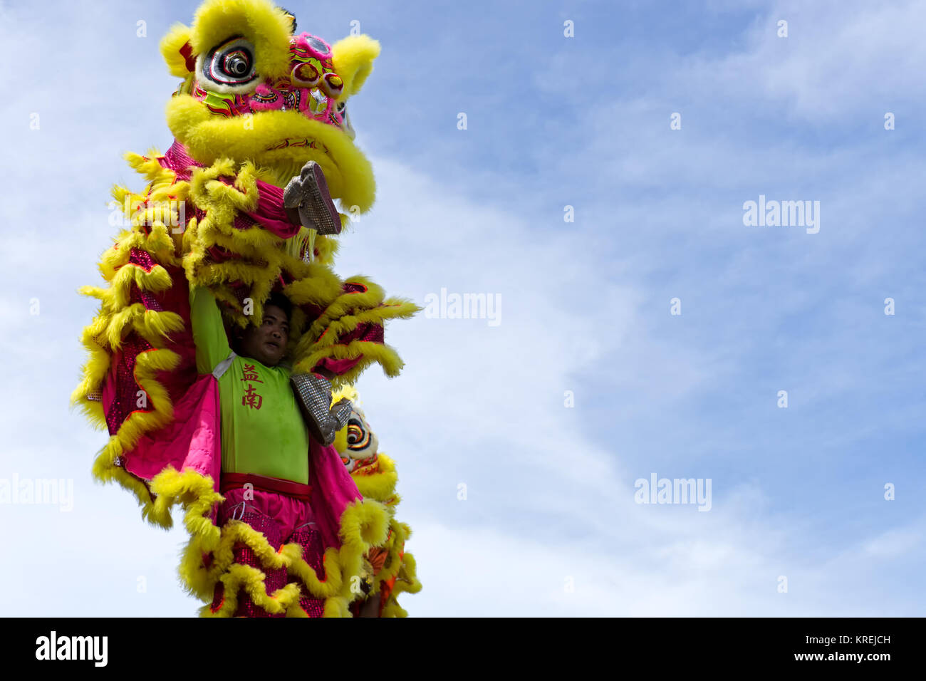 Kota Kinabalu, Malaysia - February 18, 2017: Dancer against blue sky during a dragon dance performance during Chinese - Stock Image