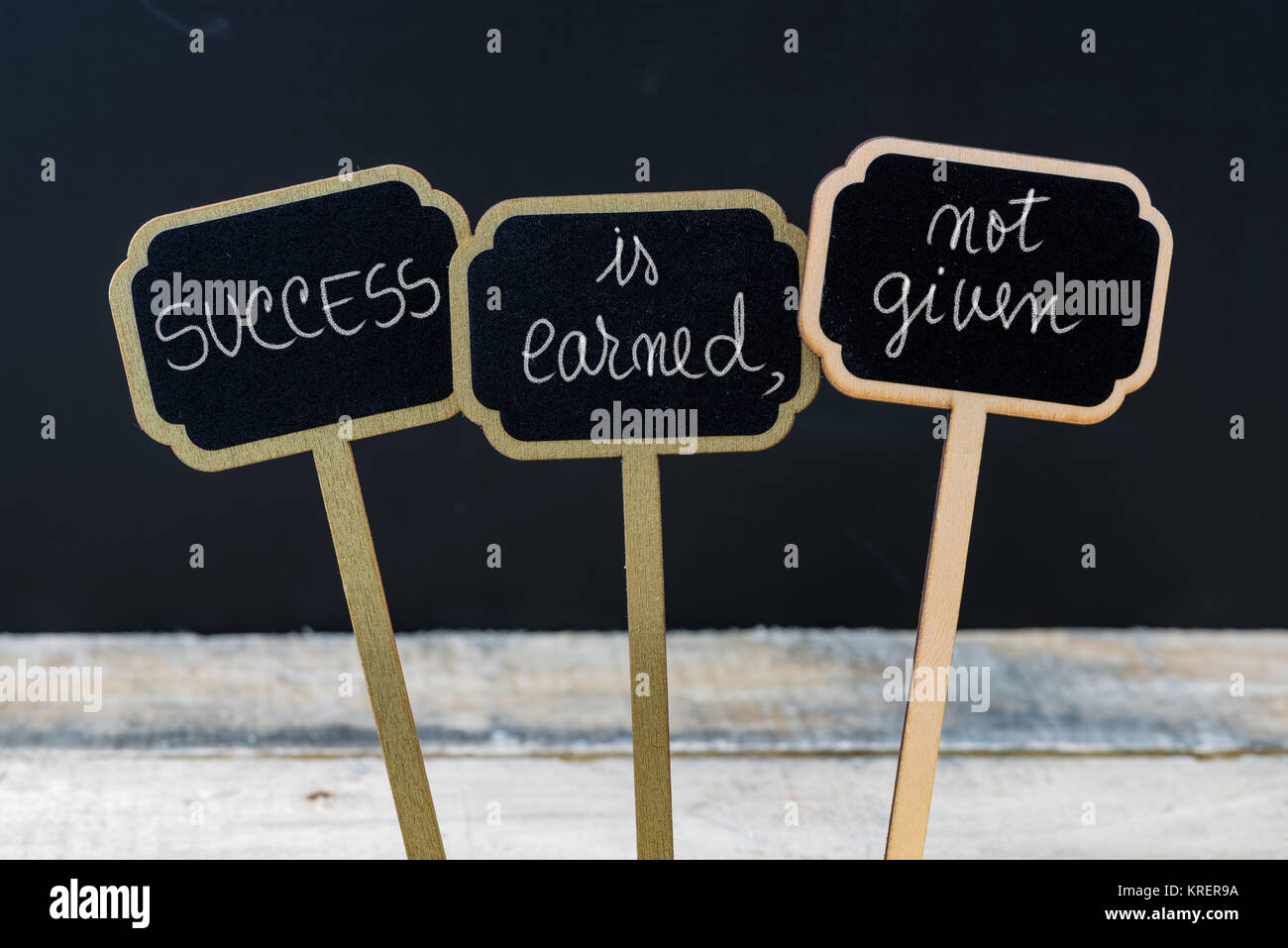 Business message SUCCESS IS EARNED, NOT GIVEN - Stock Image