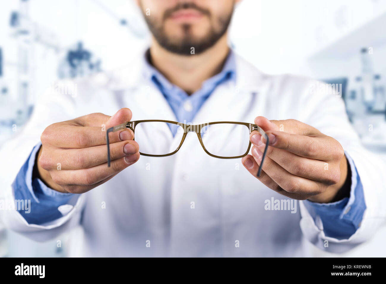 eyesight care concept - optician giving new optical glasses - Stock Image