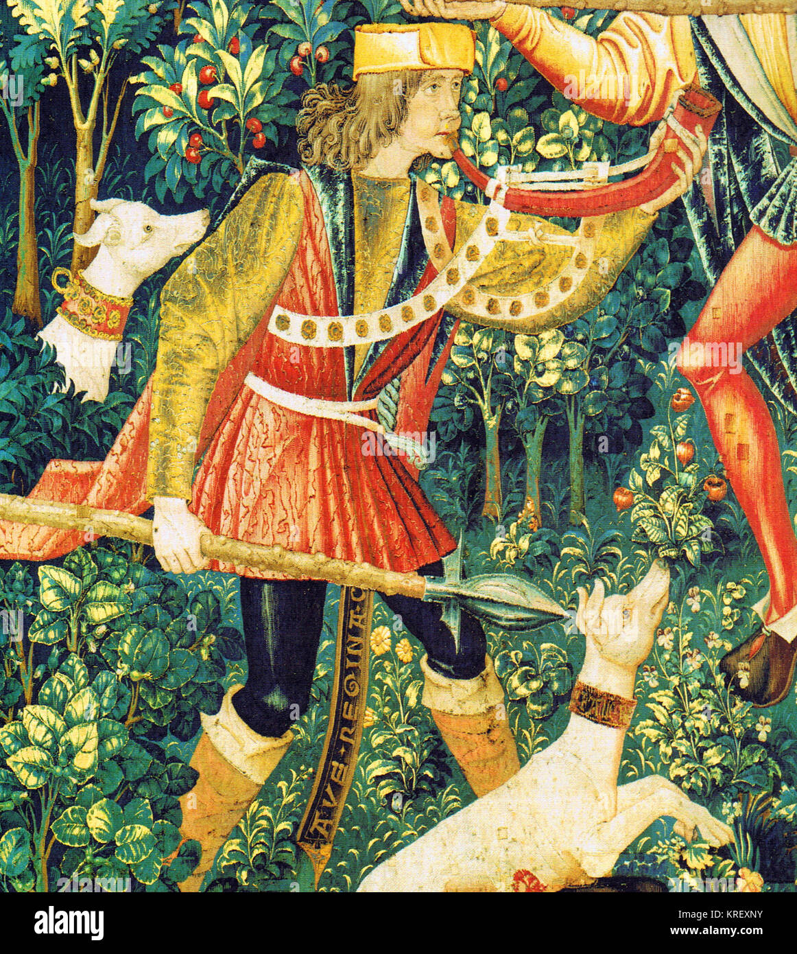 Unicorn Tapestry detail with a Hunter and dogs; - Stock Image