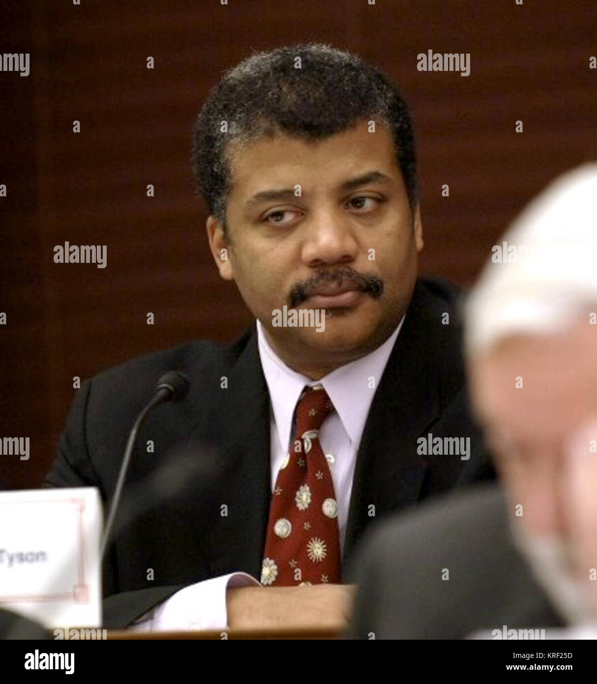Dr. Neil DeGrasse Tyson, NASA advisory Council member listens during a meeting of the council at the Rayburn Building - Stock Image