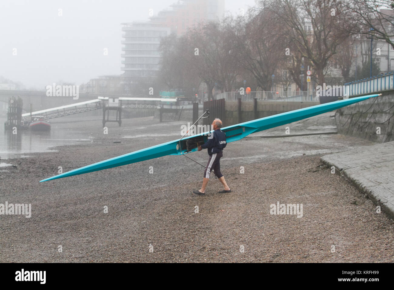 London, UK. 20th Dec, 2017. A rower takes to the water on the River Thames in Putney on a cold misty morning Credit: Stock Photo