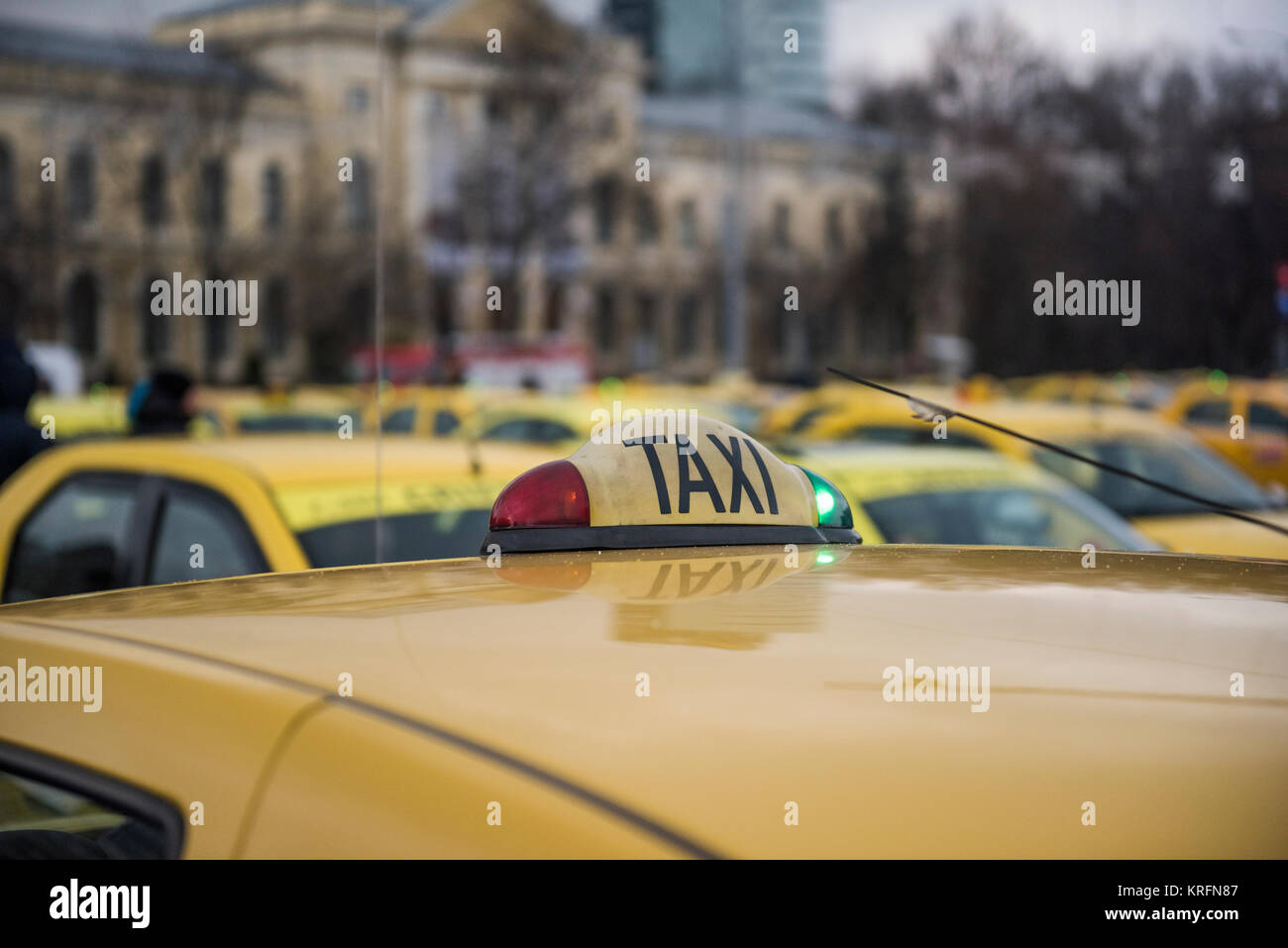 Bucharest, Romania  - December 20, 2017: Romanian taxi drivers protest in front of the government headquarters against Uber and other apps that steal their clients. Stock Photo