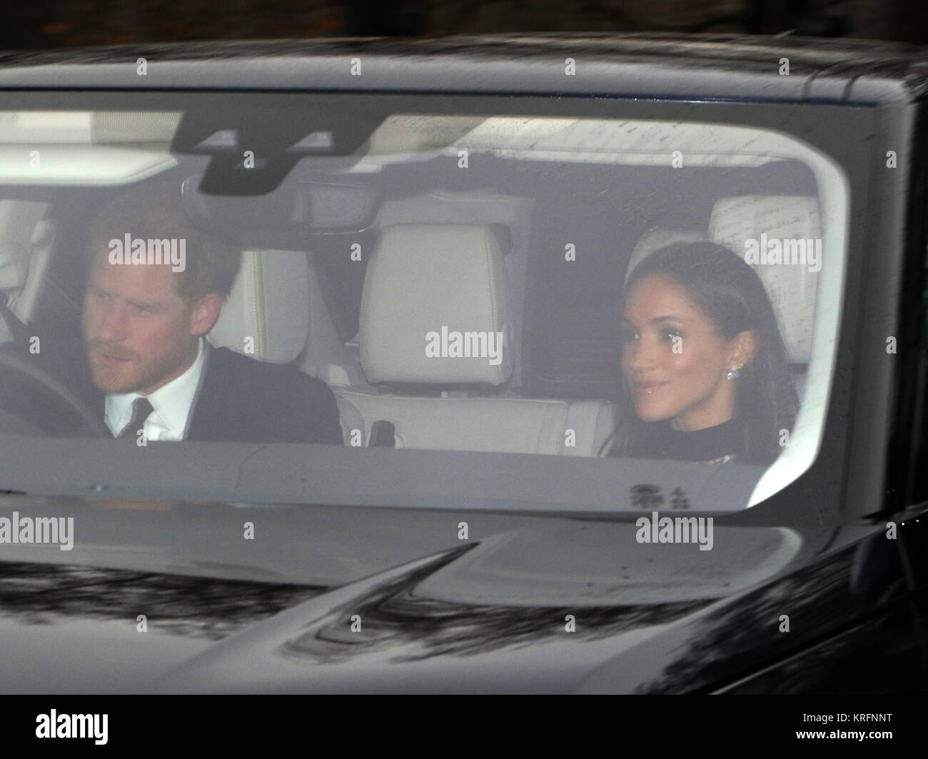 London, UK. 20th Dec, 2017. HRH Prince Harry (of Wales) and Meghan Markle arrive together before they attended HM Stock Photo