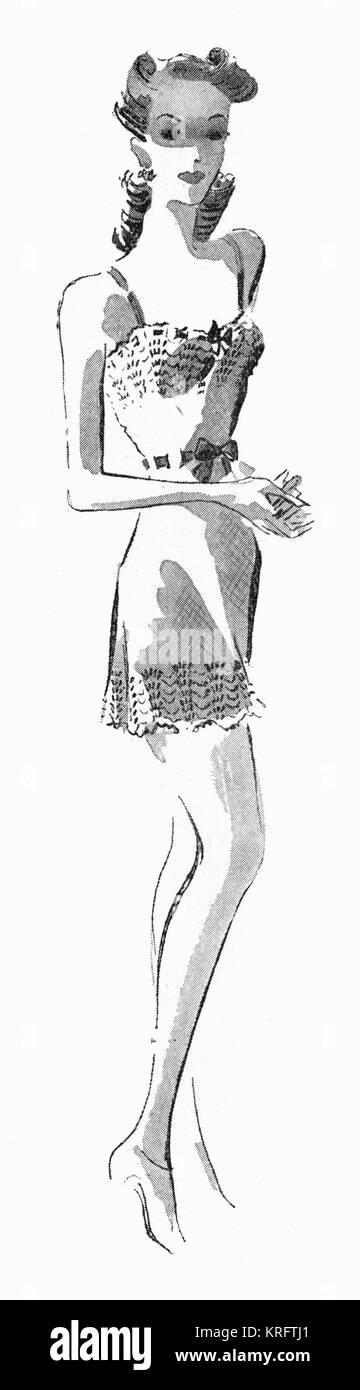 A slim lady models some hand knitted cami-knickers(camisole meets knickers), c. 1941.     Date: c. 1941 - Stock Image