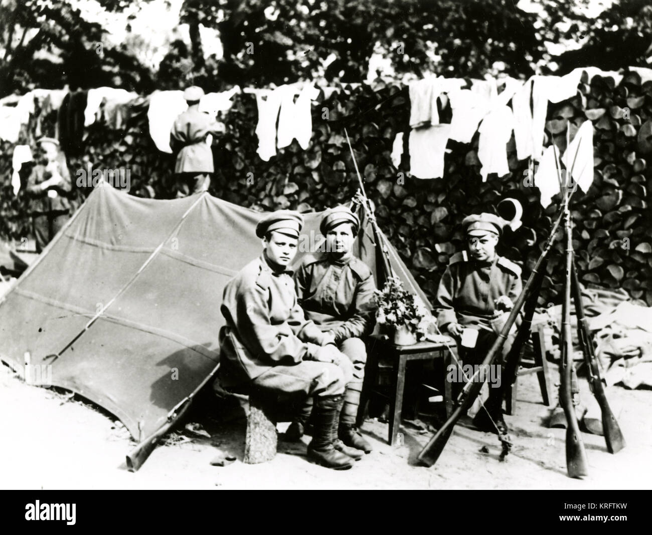 A tea break on the front taken by members of the famous 'Battalion of Death,' composed entirely of Russian - Stock Image
