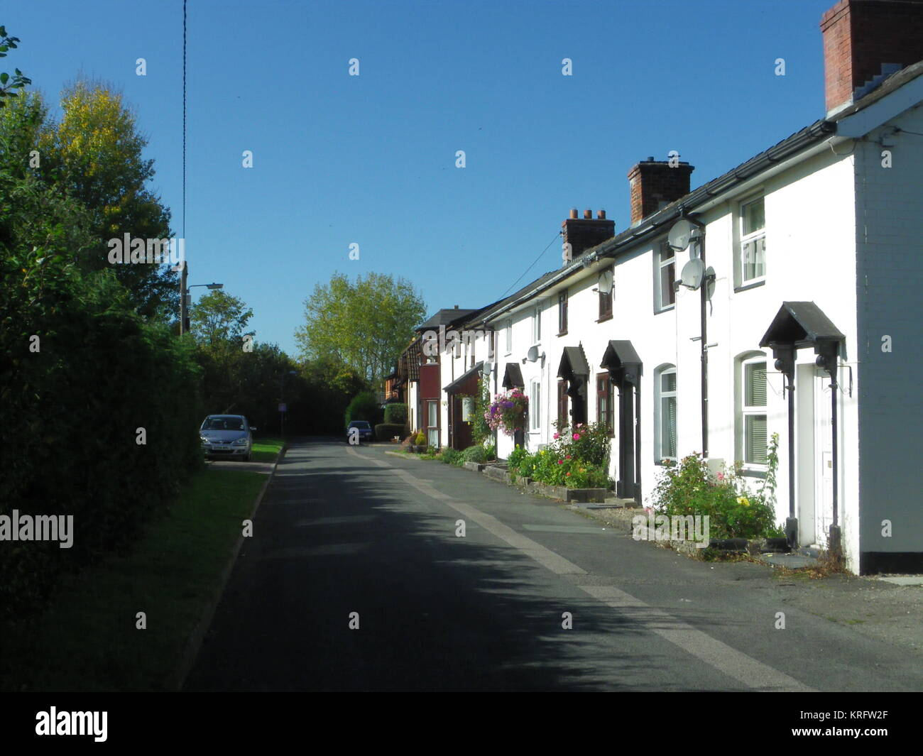 Row of white painted houses at Newtown, Powys, Wales.      Date: 2011 - Stock Image